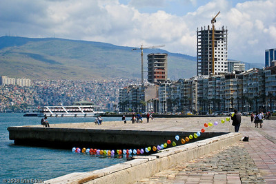 Kordon - Modern highrises overlook the Bay of İzmir.  The balloons are not in preparation for some celebration.  Rather, they are placed on the water to be used as targets by shooters who rent bee-bee guns from the vendor, sort of like one of those games of chance one might find at the midway of an amusement park.