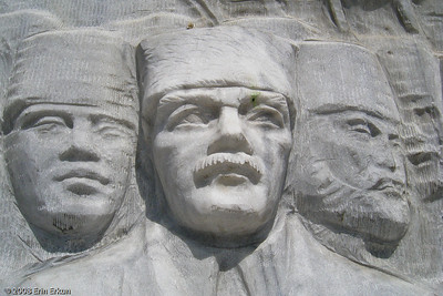 """Kordon - a closer look at the relief of Atatürk, the central figure in the scenes carved into the base of the """"Cumhuriyet Ağacı Anıtı"""" (Republic Tree Monument)."""