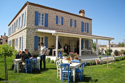 Although the breeze is a bit on the cool side, we're going to have breakfast in the garden of  Alaçat Kırevi ( http://www.alacat.com.tr/), which is located in the town of Alaçatı.  The building in the background is the main house of this delightful boutique hotel.  (Kırevi = Country Home)