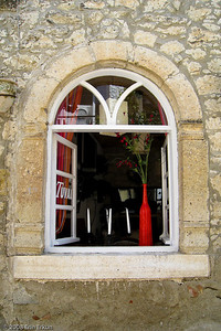 The red vase draws my eye to another window on a street in Alaçatı.