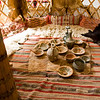"The interior of the Turkmen Tent.  Like the exterior, the furnishings inside the tent were also completely portable.  For example, the pillows (called ""Garçın""), were stuffed with clothing during the daytime, serving more or less as a wardrobe, and at night they were used as pillows.  When everyone wore their clothes for ""moving day"" (the Turkmens led a nomadic life), the pillows would be reduced to the size of a small envelope.  All of the furnishings of a Turkmen househould could be carried by a single horse or mule.<br /> <br /> There's even a Turkmen proverb that goes something like: ""A single mule carries a Turkmen house, but 40 mules can't carry the pleasure of such a house."""