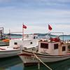 Fishing boats near the waterfront promenade on Cunda Island.