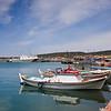 Fishing boats and Turkish Coast Guard vessel on the waterfront on Cunda Island.