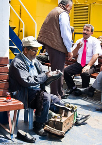 The shoe-shine man I saw earlier is still hard at work on the passenger deck.