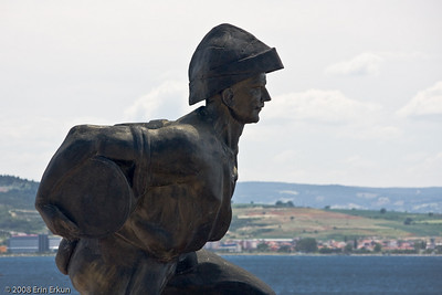 Good thing I have a zoom lens; I can get a photo of the monument without the local tourists that are swarming around it.  The lighting is not that good, but from this angle I get the Turkish mainland across the Dardanelles as a background.