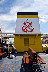 The logo on the smoke stack indicates that the ferry is operated by Türkiye Denizcilik İşletmeleri (Turkish Maritime Organization).
