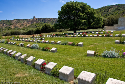 "Arıburnu Cemetery on the Anzac Cove Loop; the infamous Arıburnu Cliffs are visible to the left.  The point that sticks up from the ridge is known as the Sphinx.  From a plaque at the entrance to the cemetery:  ""At 04:30 hours on 25 April 1915, 36 rowing boats landed the first Australian soldiers around this point at Anzac Cove.  Immediately they climbed the 160 meter (528 feet) hill behind you (Plugge's Plateau) and by 10:00 hours secured a front line (seen from the Hill Road) from the Nek, Quinn's Post, Lone Pine and to the South beyond Shell Green.  100 Turkish soldiers opposed the initial landing and by day's end assisted by 8,080 reinforcements, they contained the 16,000 Australian and New Zealand soldiers landed.  By evening, each side had suffered 2,000 casualties and they were deadlocked along a front line that changed little until the Allied evacuation on 20 December 1915."""