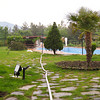 Panoramic view of the grounds behind Hotel Iliada on a misty spring morning (the white hose running through the center of the picture is the fire hose that is being used to fill the swimming pool).