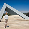 Anzac Cove Loop - Gelibolu (Gallipoli Peninsula):<br /> Aylin at the Monument near the symbolic cemetery that is still under development on the grounds of Kabatepe Museum.  Each leg of the triangle represents a different concept -  unity, energy, and triumph.  Another reason why the triangle was chosen for the monument is that each leg represents one of the three Turkish military groups that fought during the Gallipoli Campaign - the Northern Group, the Anafartalar Group, and the Southern Group.