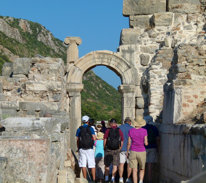 Guests walk through a Roman arch on an Ephesus cruise excursion.