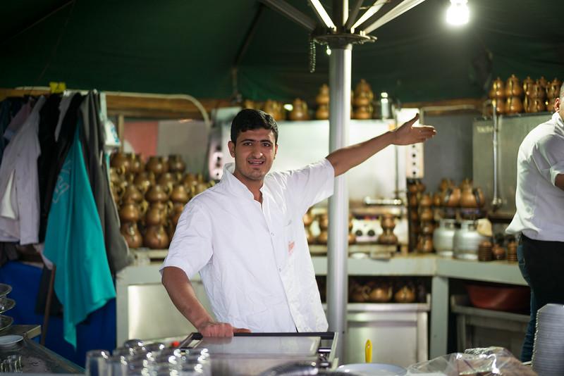 tea server introducing owner of tea cart