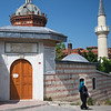 woman walking away from Mesnevihane Mosque Istanbul