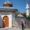 woman walking away from Mesnevihane Mosque Istanbul