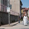 young mullah walking up street