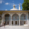 Rebecca walking toward pavilion in Topkapi Palace