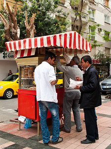 """19 April 2010 - Around Alsancak Gevrek is a popular snack sold in bakeries and by street vendors.  It is a circular bread covered with sesame seeds; it is also referred to as """"simit."""""""