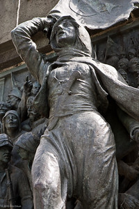 20 April 2010 - Around Alsancak Detail from one of the bronze panels on the pedestal of the monument in Cumhuriyet Meydanı (Republic Square).  This section honors the role women played in the War of Independence.