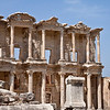 18 April 2010 - Day Trip to Efes<br /> Celsus Library - the facade of the library has two-stories, with Corinthian style columns on the ground floor and three entrances to the building. There are three window openings in the upper story. The columns at the sides of the facade are shorter than those at the center, giving the illusion of the building being greater in size.