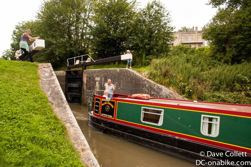 Canal boat heading through Bath
