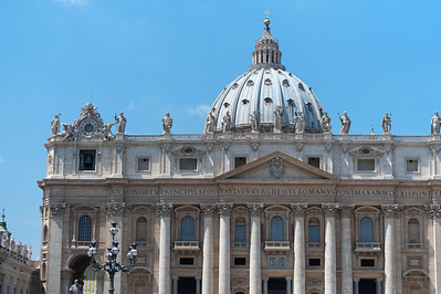 The statues of saints and dome in St Peter's Basilica - Vatican City
