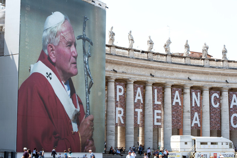 The pope and statues at the colonnades in St Peter's Square - Vatican City