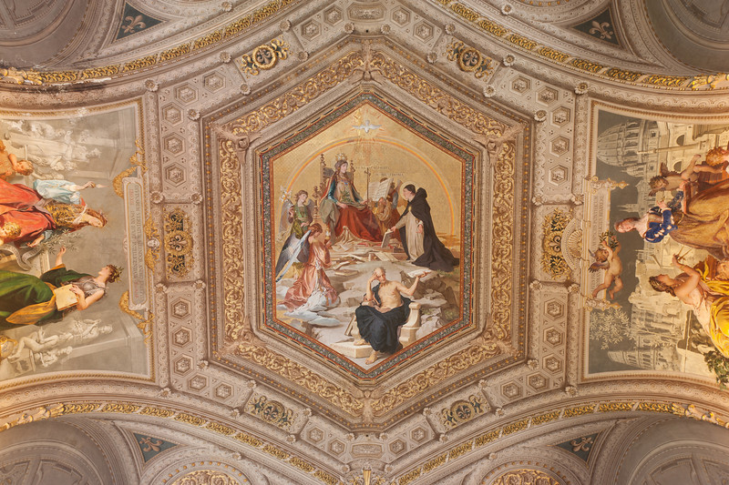 Religious fresco on the ceiling of Vatican Museums in Rome, Italy