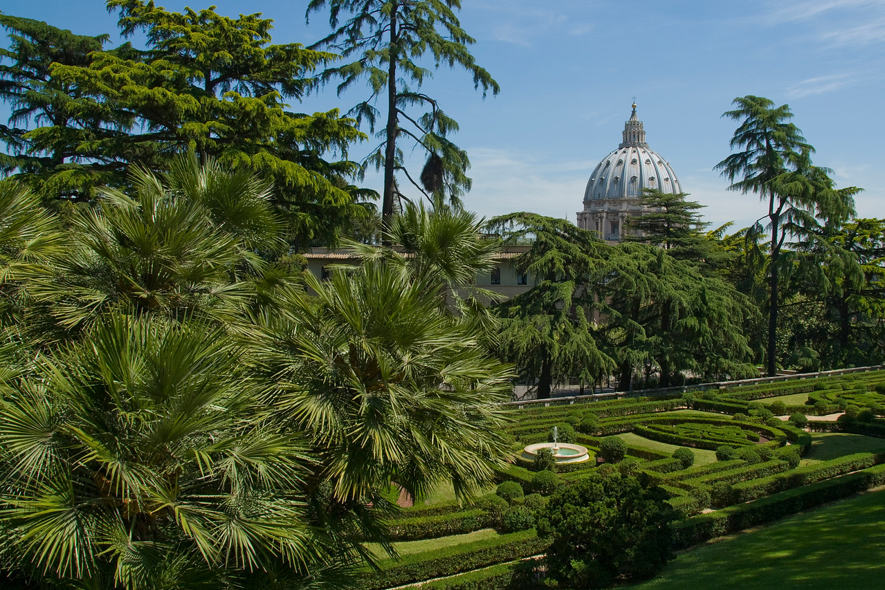 Giardini Vaticani (Vatican Gardens) with view of Michaelangelo's dome in Vatican City