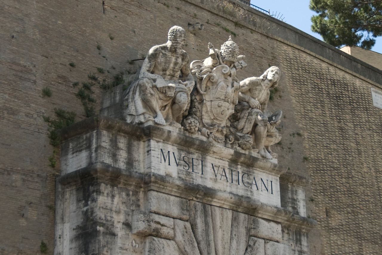 Statues of Michelangelo and Raphael Over the Vatican Museums Entrance - Rome, italy