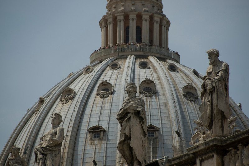 Statues of saints and dome at St Peter's Basilica - Vatican, Rome, italy