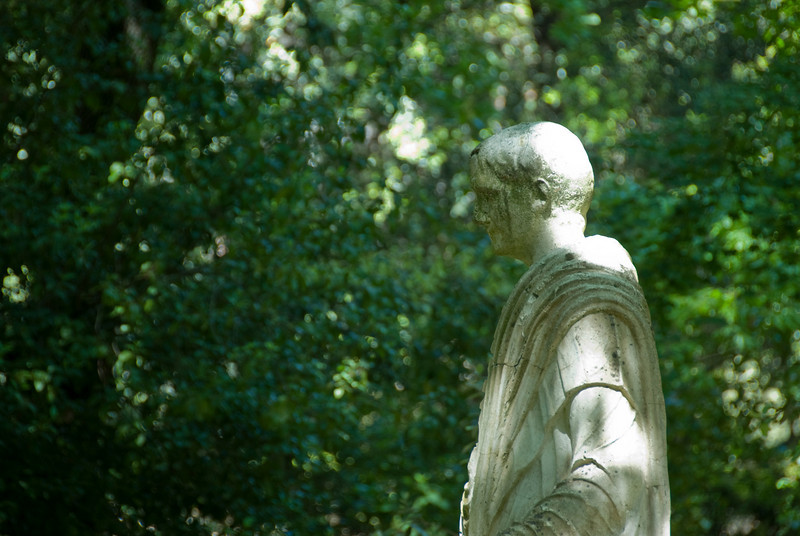 Statue of a boy wearing a bulla in Vatican City Gardens