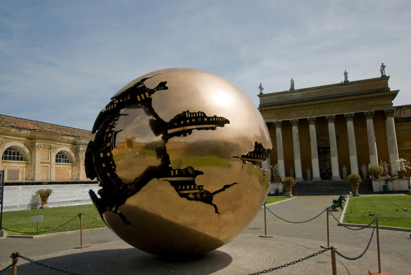 """Bronze """"Sphere within Sphere"""" sculpture outside Vatican Museums in Italy"""