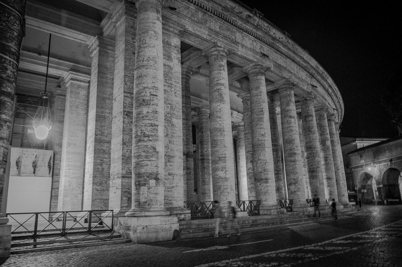 The colonnades at St Peter's Square at night - Vatican, Rome, Italy