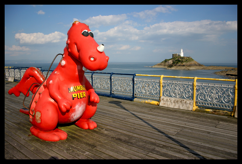 Mumbles Pier and Mumbles Lighthouse.