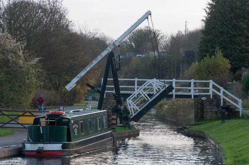 Canal boat passing through drawbridge in Llangollen Canal in Wales