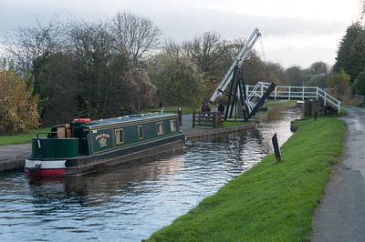 Canal boat passing through wooden drawbridge in Llangollen Canal in Wales