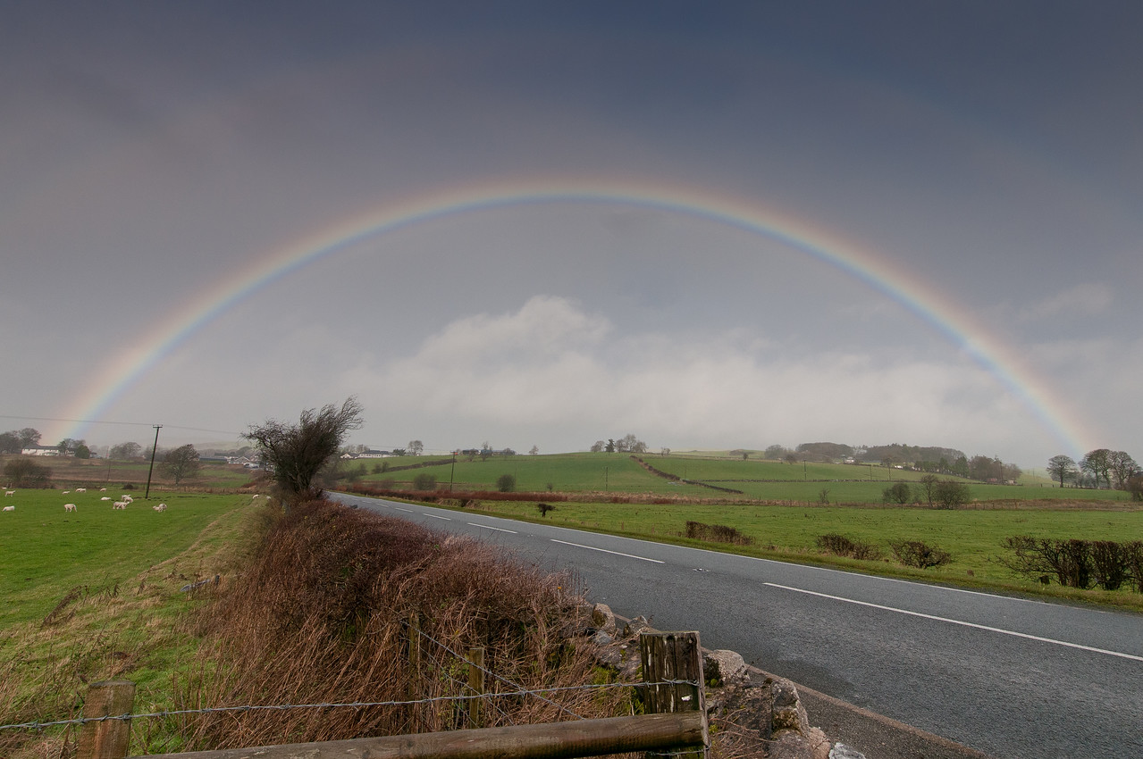 Rainbow over green field landscape in Wales, England