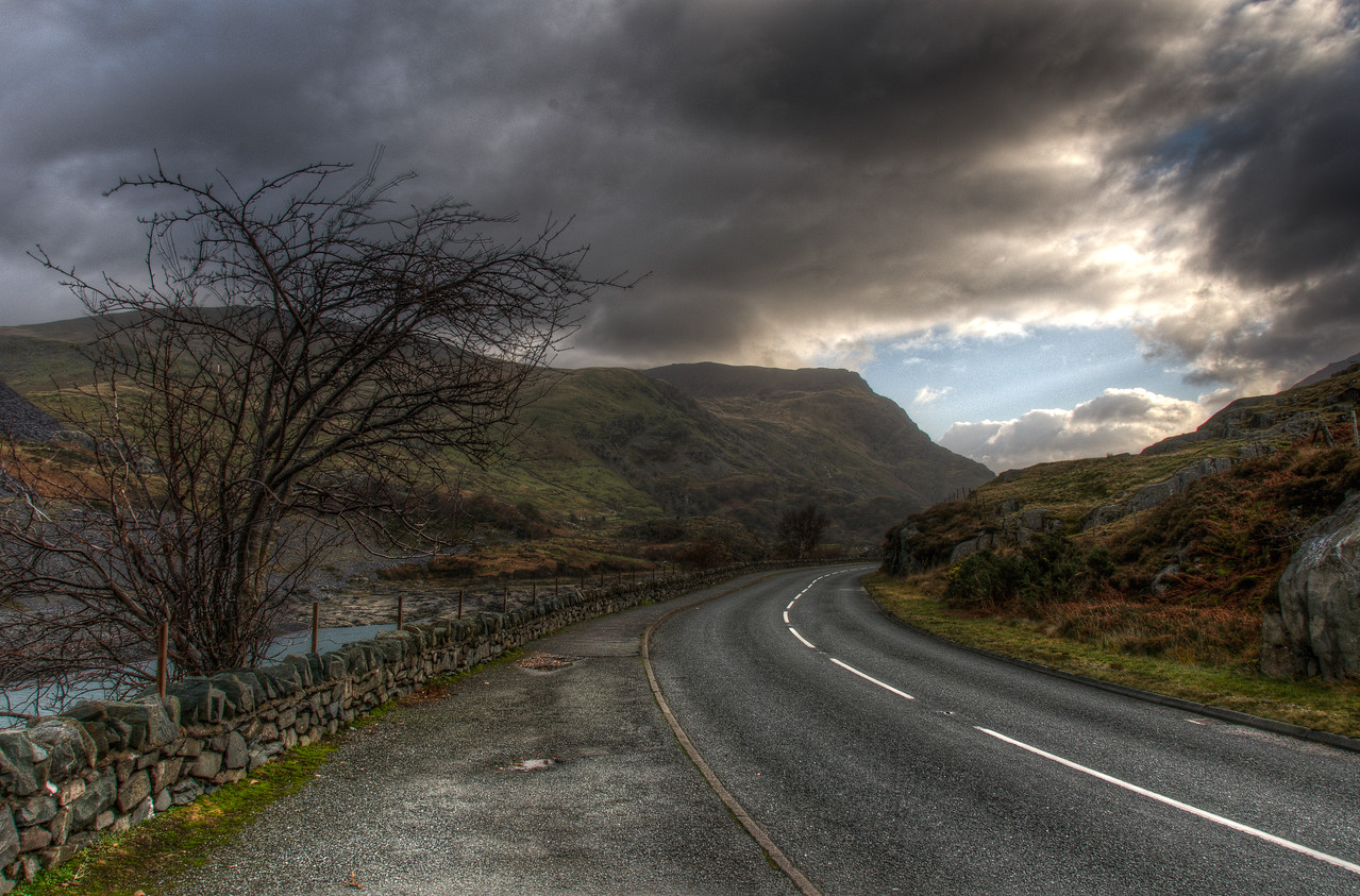 Heavy clouds over empty road in Wales, England