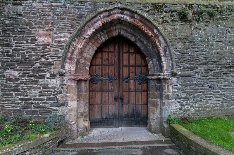 Wooden entrance door at Chepstow Castle in Wales, England