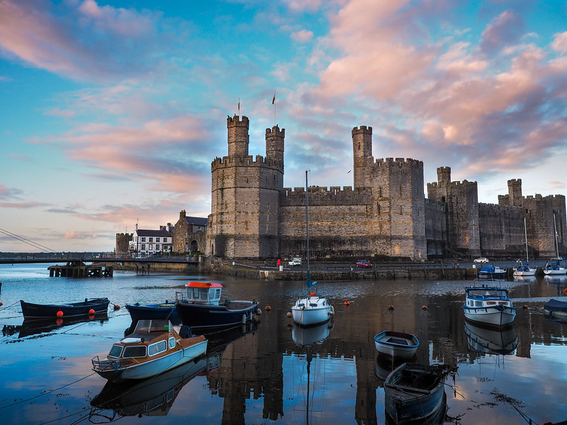 Caernarfon Castle and harbour at sunset