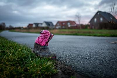 An old children shoe in Wilhelmshaven, Germany.
