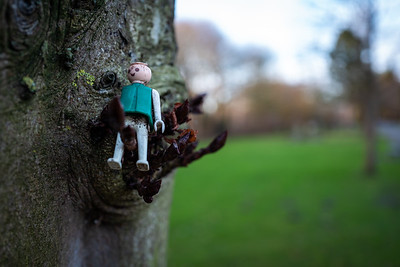 Wilhelmshaven, Germany - December 27, 2018: An old playmobil statue in a tree.