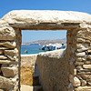 Looking through a wall out onto the sea on Mykonos, Greece.