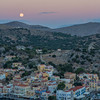 Moonset and sunrise over Symi