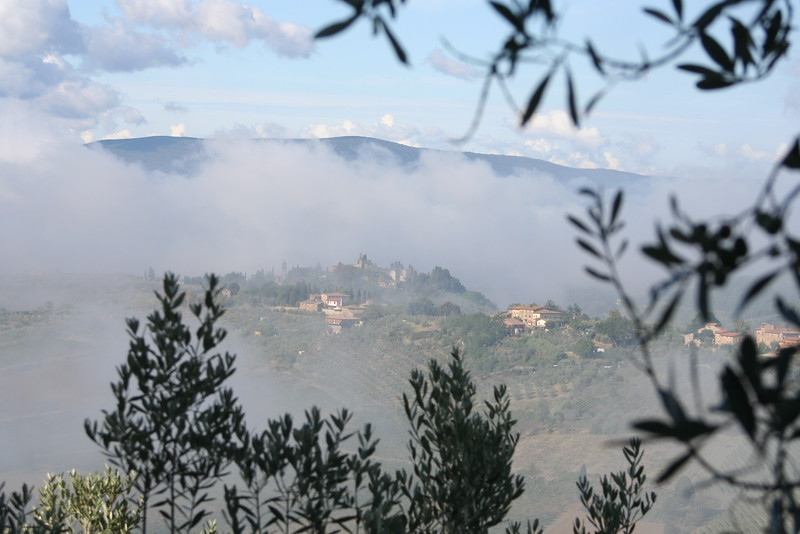 Tuscan village through the morning mist