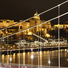 Budapest night scene through suspension bridge