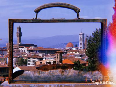Florence, Italy seen through the Briefcase Sculpture by Belgian artist Jean-Michel Folon