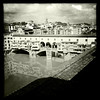"""Ominous clouds over the Ponte Vecchio as a banner advocates saying """"no"""" to nuclear power. Florence, June 10, 2011."""