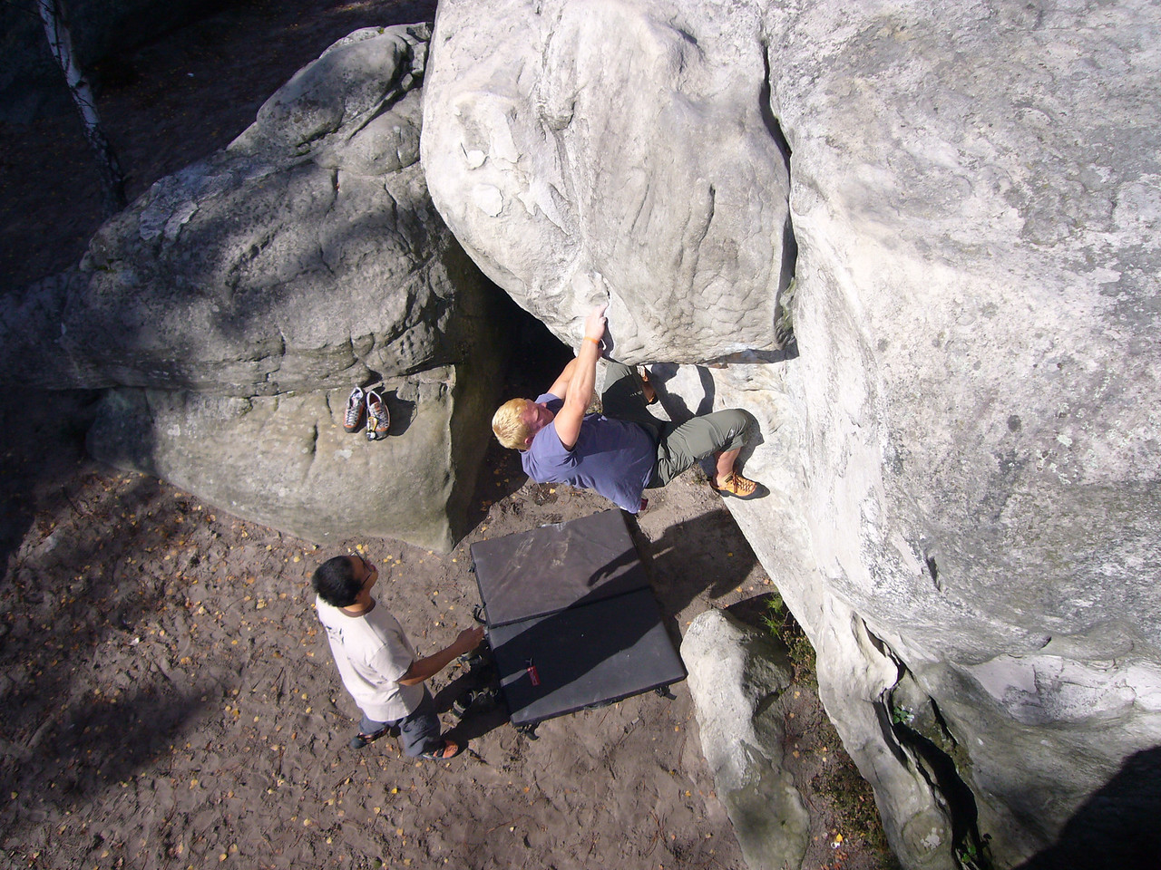 Second day, new area, and lots of great problems!  Here Brian pulls hard on this fun traverse to the crack topout.