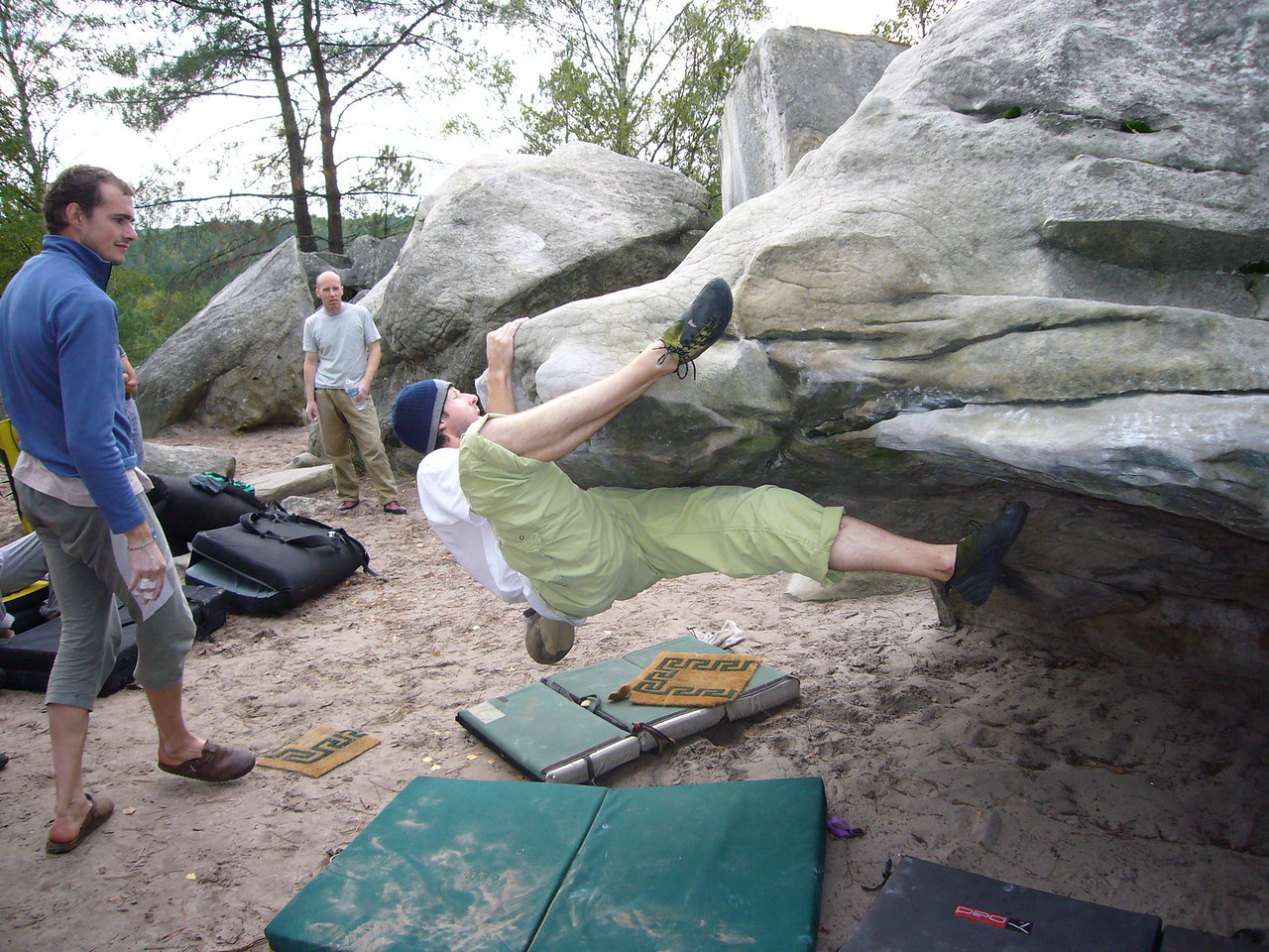 Lots of heel hooking and slapping gets you around this rock then feet go the other direction, grab higher holds and topout.