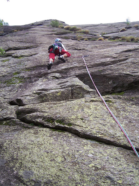 Giulio leads the first pitch up a slab climb.  We are here because it's a short approach and the weather is iffy.  I led half of the 2nd pitch which is 6b.  6b slab is getting close to my limit, then it started to rain.  I contemplated the next move on blank wet rock for 5 minutes before exiting right to a slippery crack.  Made it to the anchors in the pouring rain.